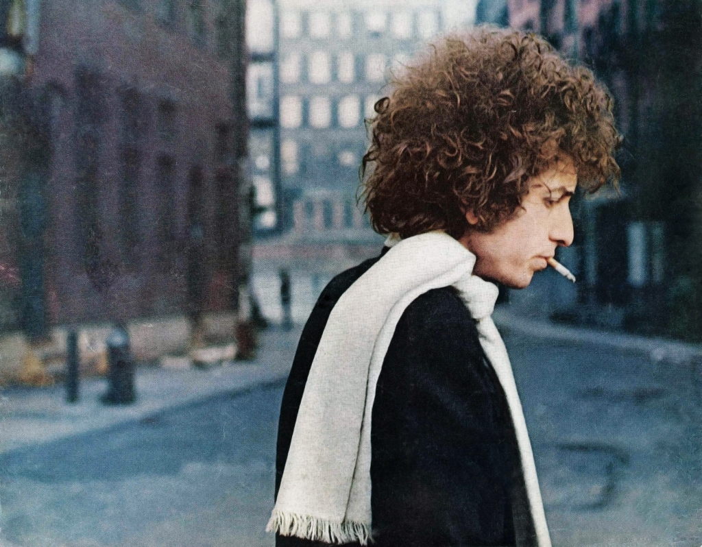 "This image was commissioned by The Saturday Evening Post for a piece they ran on Dylan. ""I took him near the Brooklyn Bridge for it,"" says Schatzberg. ""I liked shooting in downtown Manhattan. This became the cover of the new book."""