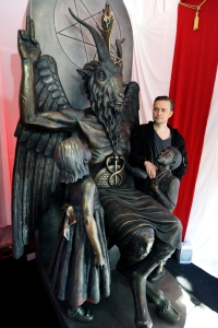 Lucien Greaves stands next to a 9-foot statue of the goat-headed idol Baphomet at the international headquarters of the Satanic Temple in Salem, Mass., 2016.