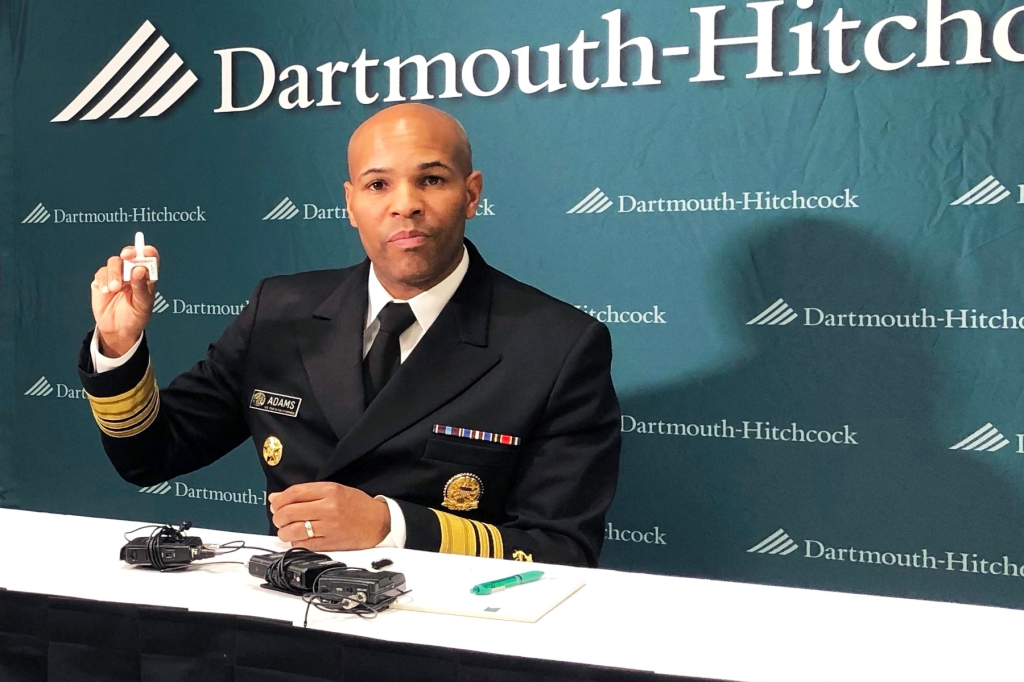 U.S. Surgeon General Jerome Adams holds up a nasal spray dose of naloxone, an opioid overdose reversing drug