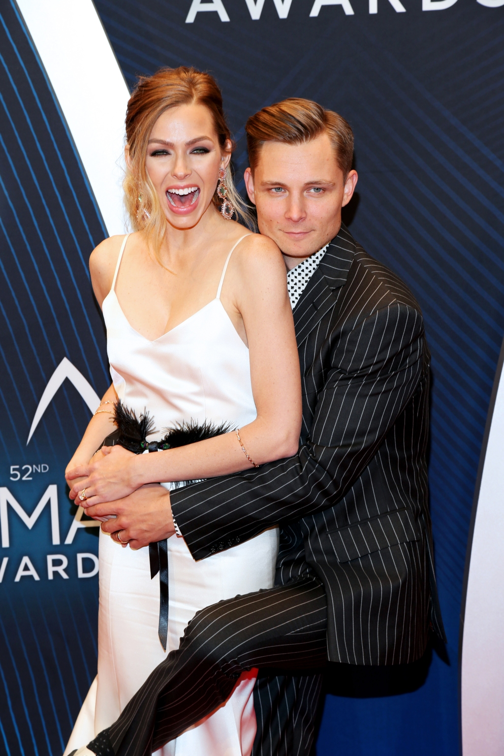 """Sunshine & Whiskey"" singer Frankie Ballard gets close with Christina Murphy on the CMA Awards red carpet."