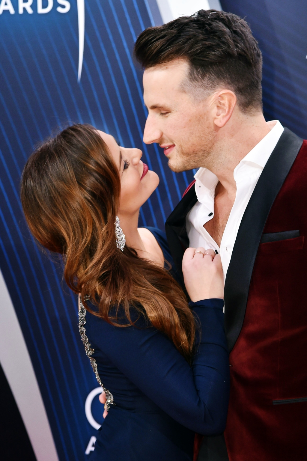 "Singer Russell Dickerson, who scored his first Number One with the song ""Yours,"" arrives at the 2018 CMA Awards with wife Kailey."