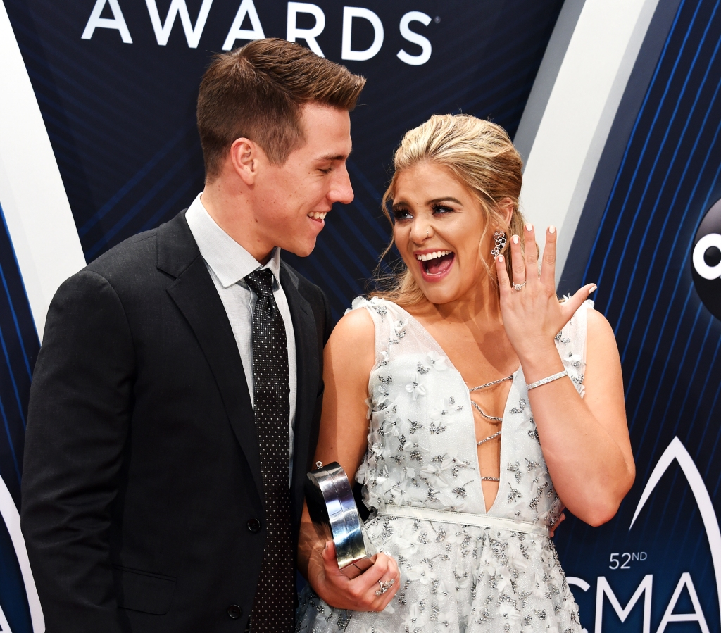 Lauren Alaina, who performed a tribute to Country Hall of Famer Dottie West, arrives on the 2018 CMA red carpet with Alex Hopkins.