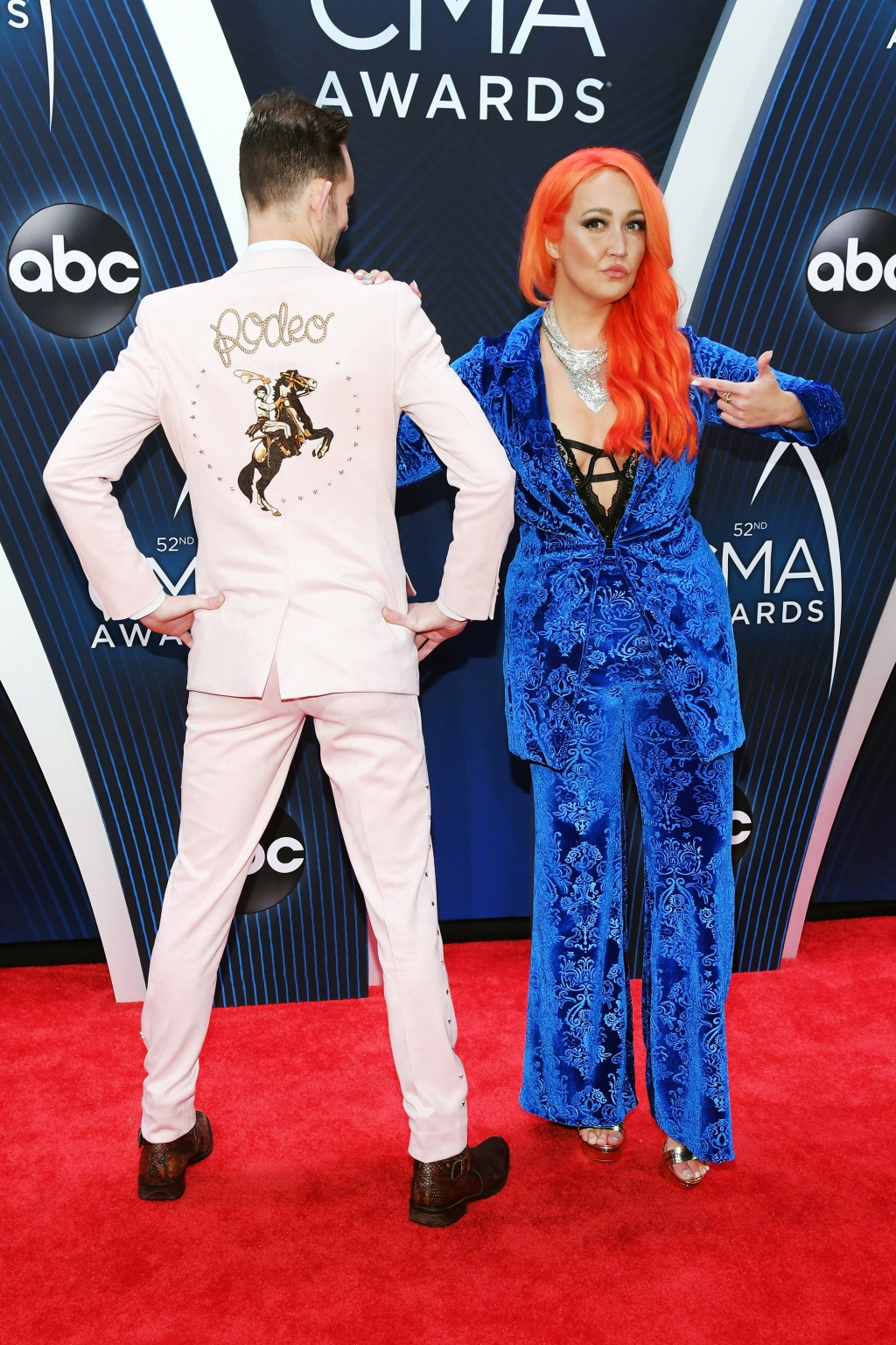 Singer Meghan Linsey and Tylerr Cain show off their colorful side on the 2018 CMA Awards red carpet.