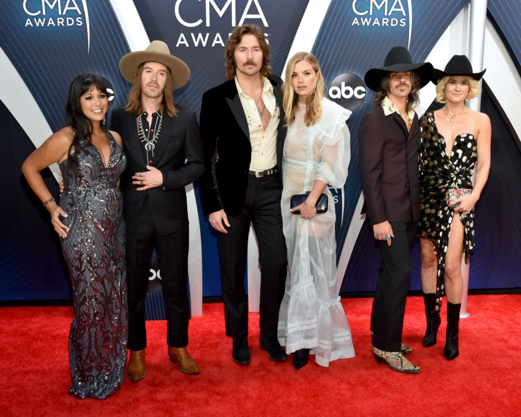 "Midland's Jess Carson, Mark Wystrach and Cameron Duddy arrive at the CMA Awards, where they performed Jerry Reed's ""East Bound and Down"" in tribute to the late Burt Reynolds."