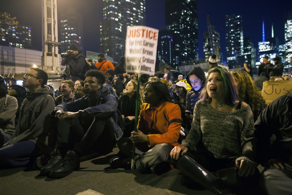 People Block the Entrance to the Lincoln Tunnel in Protest Against the Decision of a Grand Jury not to Indict a Police Officer Involved in the Death of Eric Garner in New York New York Usa 03 December 2014 a Grand Jury in Staten Island New York Voted Today That There was not Enough Evident to Indict New York City Police Officer Daniel Pantaleo who was Administering a Chokehold to Garner in July when He Died Us Attorney General Eric Holder Asked Protesters to Be Peaceful and Launched a Federal Probe Into the Choking Death of an Unarmed African American who was Being Restrained by Police Holder Said That Eric Garner who was 43 'Died Tragically' at the Hands of Police and That Federal Investigators Would Conduct an 'Independent Thorough and Fair' Investigation to See if His Civil Rights Had Been Violated the Federal Probe Will Follow the Refusal of a Grand Jury to Indict the Police Officer who Restrained Garner Holder Said That Garner's Death in July Along with the Shooting Death of an Unarmed African American Michael Brown by a White Policeman in Ferguson Missouri in August 'Have Tested the Sense of Trust Between Law Enforcement and the Community They Are Charged to Protect ' United States New YorkUsa Garner Protest - Dec 2014