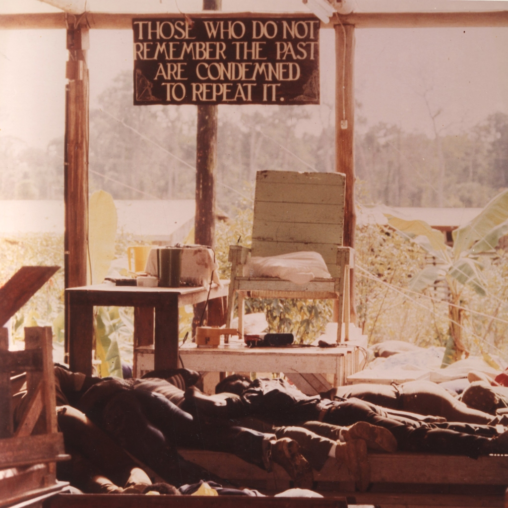 JONESTOWN, GUYANA - 1978: Inside the People's Temple in Jonestown, Guyana. The bodies of followers that drank the cyanide-laced drink are strewn around the commune. More than 900 Americans died in a murder and suicide ritual at the Peoples Temple agricultural mission in the jungle of Guyana. (Photo by The Washington Post/Getty Images)