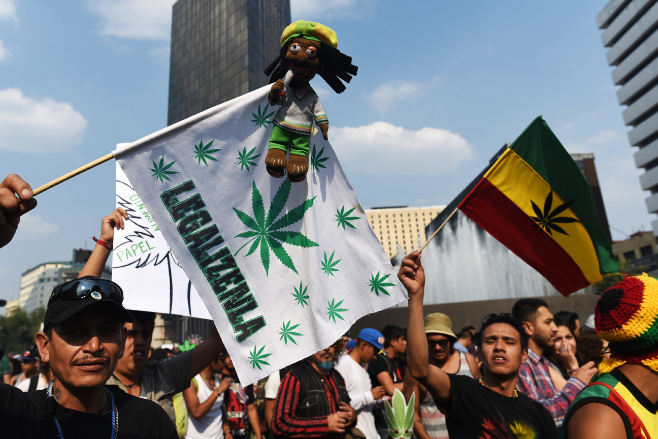 Activists march along Reforma Avenue in Mexico City on May 6, 2017 demanding the depenalization of marijuana.