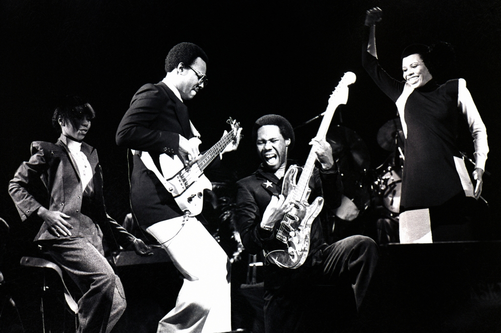 Chic perform on stage in London, October 1979. Left to right: Luci Martin, Bernard Edwards, Nile Rodgers and Alfa Anderson. (Photo by Gus Stewart/Redferns)