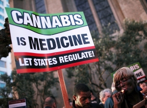 Medical marijuana advocates hold signs as they demonstrate on February 16, 2012 in San Francisco, California. Photo: Justin Sullivan/Getty Images