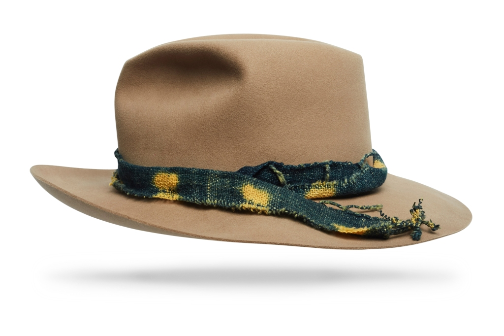 The Vagabond by Worth & Worth has a collapsible lid that never loses its shape. Made of 100 percent -beaver and finished with a hand-woven -double-dipped shibori-dyed band. hatshop.com $725