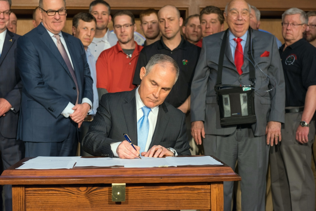 FILE -- Scott Pruitt, then the head of the Environmental Protection Agency, signs executive orders as energy industry figures including Robert Murray, right with breathing apparatus, look on, in Washington, March 18, 2017. At his confirmation hearing, senators are likely to grill Andrew Wheeler over his lobbying work and ties to Murray. (Eric Vance/Environmental Protection Agency via The New York Times) -- FOR EDITORIAL USE ONLY --