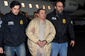 "Provided U.S. law enforcement, authorities escort Joaquin ""El Chapo"" Guzman, center, from a plane to a waiting caravan of SUVs at Long Island MacArthur Airport, in Ronkonkoma, N.Y. New York prosecutors have asked on Tuesday, March 7, that any Mexican attorneys that want to join Guzman's defense team must first be vetted by the U.S. government in order to avoid any sensitive information falling into the hands of the Sinaloa drug cartelMexico U.S. Drug Lord, Ronkonkoma, USA - 19 Jan 2017"