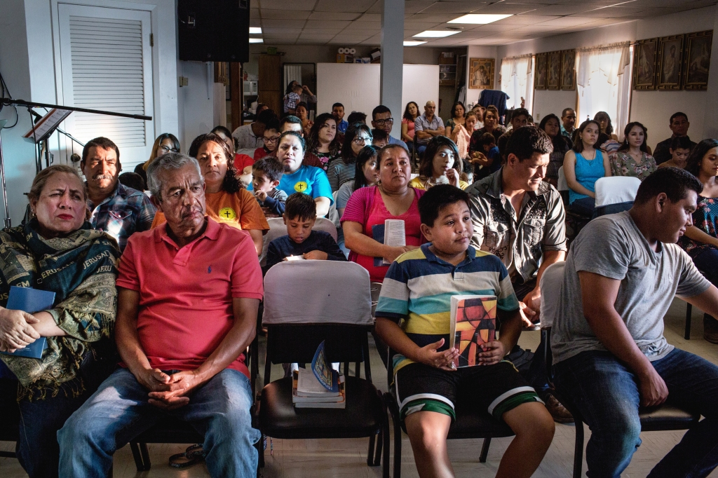 October 7, 2018. Bean Station, Tennessee. The congregation during services at St Patrick's church in Bean Station. After a major ICE raid at the Southeastern Provisions slaughterhouse in Bean Station, TN, the latino community in the surrounding area of Morristown and Grainger County has been deeply affected by fear, job loss, and deportations of family members or pending deportation proceedings. (Natalie Keyssar for Rolling Stone)