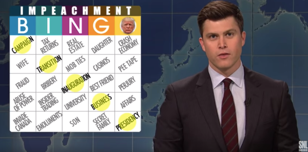 Colin Jost next to an impeachment bingo card
