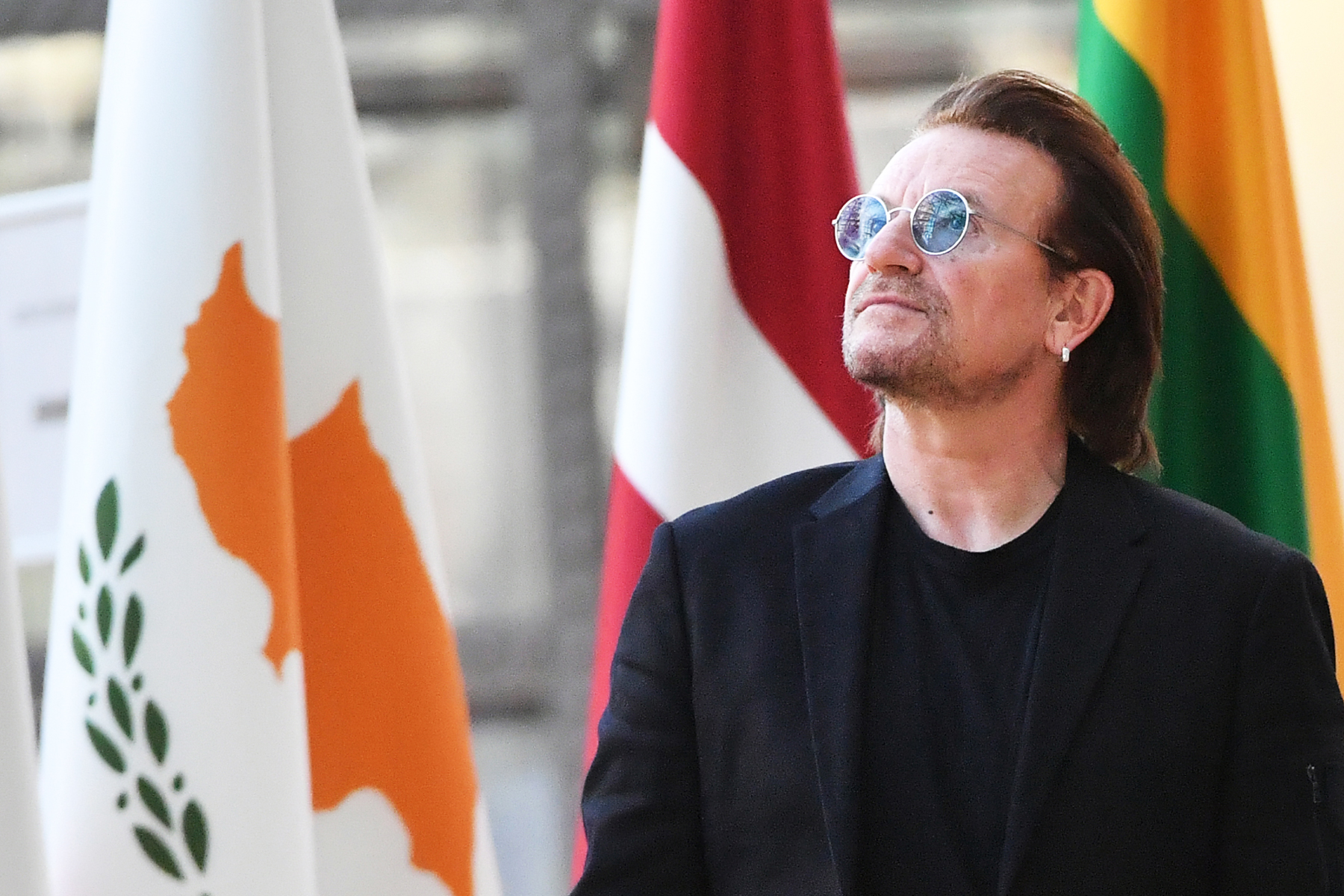 Bono looks up upon his arrival at the European Council in Brussels on October 10, 2018.