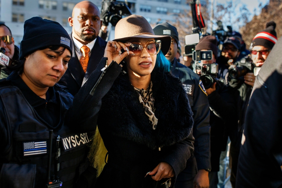 Cardi B, center, arrives at Queens County Criminal Court, in New York on Dec. 8, 2018.