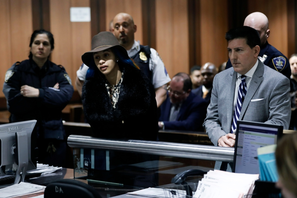US rapper and hip-hop artist Cardi B (C) appears with her attorney Jeff Kern (R) at Queens criminal arraignment court for a hearing on misdemeanor charges against her stemming from a fight in a New York strip club in summer 2018, in Queens, New York, USA, 07 December 2018.Cardi B court appearence in New York, USA - 07 Dec 2018