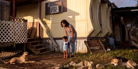October 7, 2018. Bean Station, Tennessee. Yahel, who's husband was deported to Mexico after the raid, plays with her son outside their trailer in Bean Station which she shares with her mother. After a major ICE raid at the Southeastern Provisions slaughterhouse in Bean Station, TN, the latino community in the surrounding area of Morristown and Grainger County has been deeply affected by fear, job loss, and deportations of family members or pending deportation proceedings.(Natalie Keyssar for Rolling Stone)