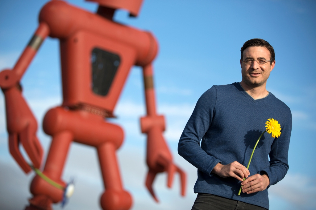 Vince Kadlubek, CEO of Meow Wolf with Christian Ristrow's Becoming Human Sculpture