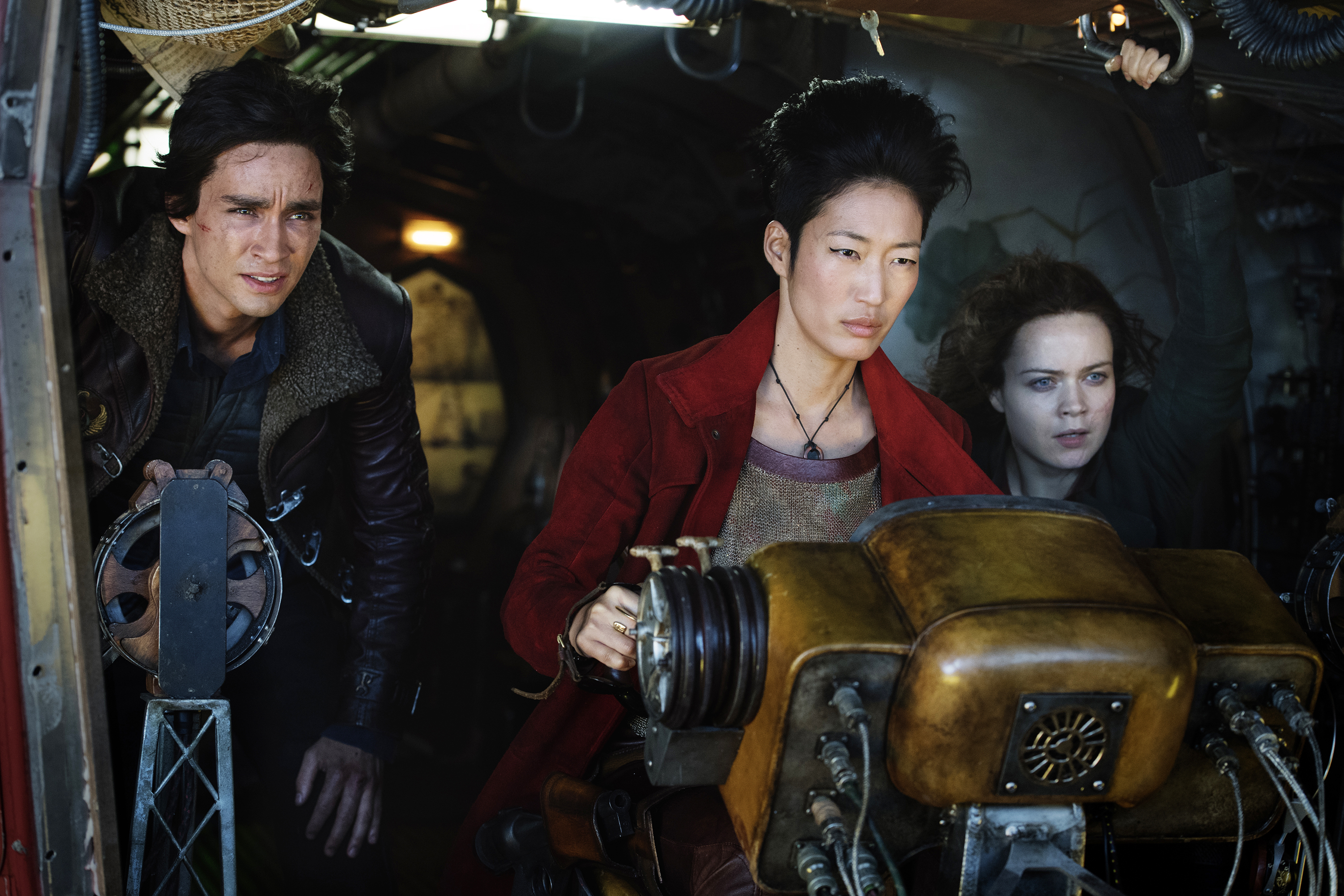 """(from left) Robert Sheehan as Tom Natsworthy, Jihae as Anna Fang and Hera Hilmar as Hester Shaw in """"Mortal Engines."""" The film is directed by Christian Rivers, and written by Fran Walsh, Philippa Boyens and Peter Jackson based on the novel by Philip Reeve."""