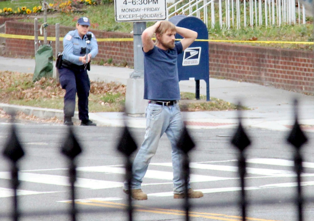 "FILE - In this Dec. 4, 2016 file photo, Edgar Maddison Welch, 28 of Salisbury, N.C., surrenders to police in Washington. Welch, a man who police said was inspired by false internet rumors dubbed ""pizzagate"" to fire an assault weapon inside a Washington pizzeria pleaded guilty Friday, March 24, 2017, to two charges. (Sathi Soma via AP, File)"