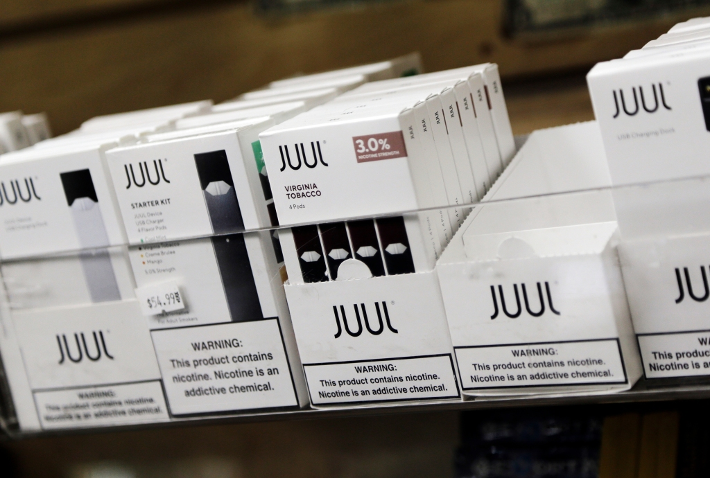 Juul products are displayed at a smoke shop in New York, . Altria, one of the world's biggest tobacco companies, is spending nearly $13 billion to buy a huge stake in the vape company Juul as cigarette use continues to declineAltria Juul, New York, USA - 20 Dec 2018