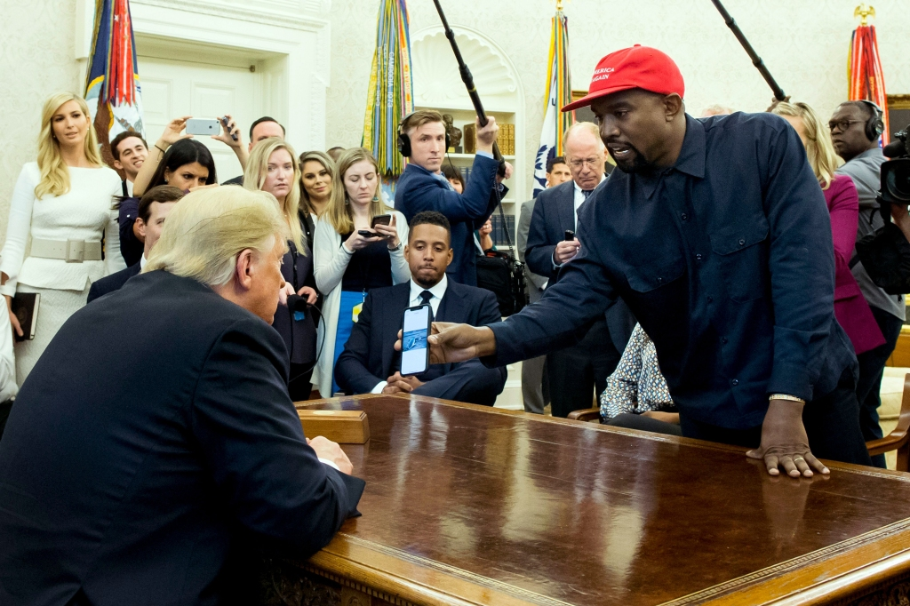 US entertainer Kanye West (R) shows a cell phone depicting the image of an aircraft to US President Donald J. Trump (L) during their meeting in the Oval Office of the White House in Washington, DC, USA, 11 October 2018. Kanye West, who is a Trump supporter, met with the President to discuss prison reform and other issues.US President Donald J. Trump meets with US entertainer Kanye West and retired football player Jim Brown, Washington, USA - 11 Oct 2018