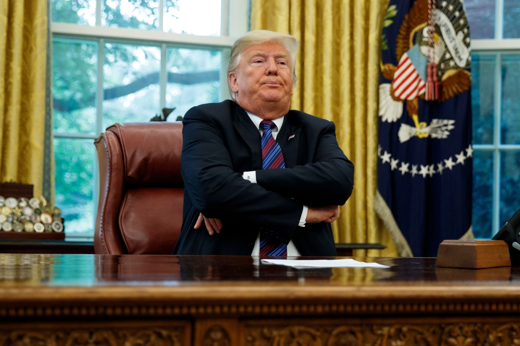"President Donald Trump crosses his arms after speaking with Mexican President Enrique Pena Nieto on the phone about a trade agreement between the United States and Mexico, in the Oval Office of the White House, in Washington. Trump has bowed to widespread pressure from veterans groups and others to do more to honor John McCain's death. Trump on Monday ordered flags at the White House and elsewhere lowered to half-staff until the six-term senator is buried Sunday. He also proclaimed ""respect"" for McCain, with whom he feuded bitterly for years. It was a marked reversal from Trump's refusal to comment on McCain. Earlier Monday, the White House flag had been raisedTrump McCain, Washington, USA - 27 Aug 2018"