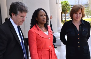 Marissa Alexander (C) stands with her legal team, defense co-counsel Bruce Zimet (L) and Faith Gay as they speak to reporters outside the Duval County Courthouse in Jacksonville, Florida June 10, 2014. Alexander was initially convicted in 2012 and sentenced to 20 years in jail after firing what the mother of three described as a warning shot into the kitchen wall of her home in the direction of her estranged husband. Her sentence was later overturned on appeal but prosecutors are seeking a retrial which now will be postponed until December 1, 2014. REUTERS/Bob Mack/The Florida Times-Union/Pool (UNITED STATES - Tags: CRIME LAW SOCIETY) - TM3EA6A0ZNU01