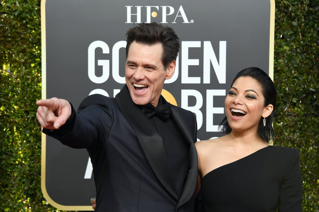 Jim Carrey and Ginger Gonzaga arrive to the 76th Annual Golden Globe Awards held at the Beverly Hilton Hotel on January 6, 2019.