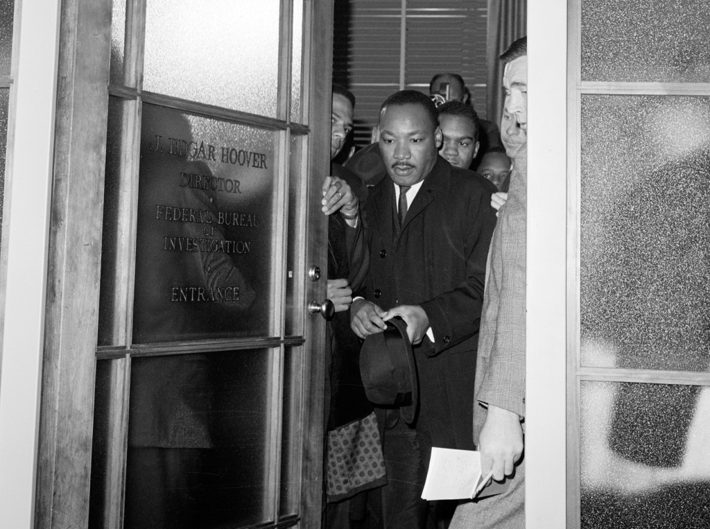 After a meeting with FBI Director J. Edgar Hoover, Reverend Martin Luther King leaves the FBI building in Washington DC.