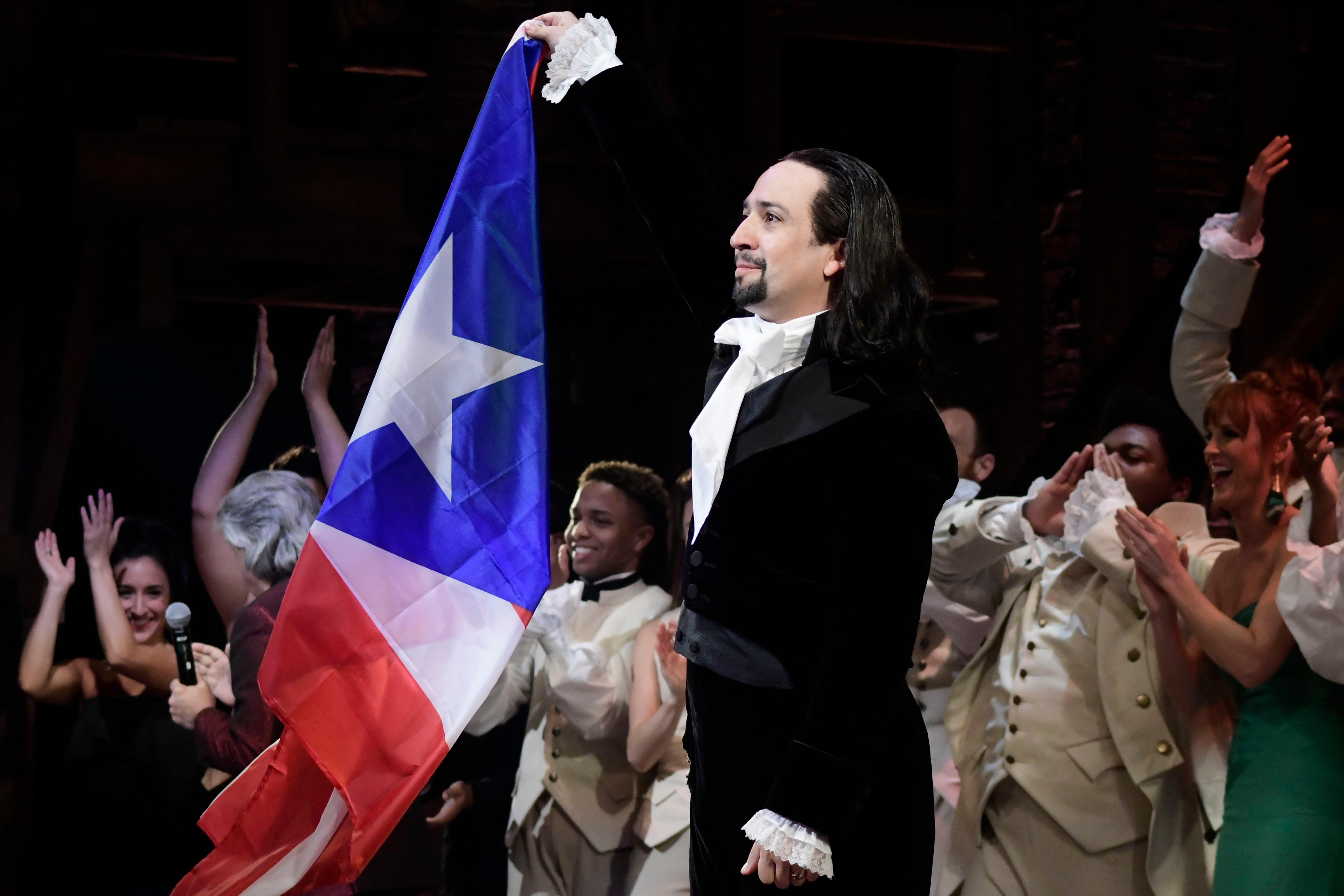 Lin-Manuel Miranda, composer and creator of the award-winning Broadway musical, Hamilton, proudly waves a Puerto Rican flag after receiving a standing ovation at the end of the play's premiere held at the Santurce Fine Arts Center, in San Juan, Puerto Rico, . The musical is set to run for two weeks and will raise money for local arts programsHamilton, San Juan, Puerto Rico - 11 Jan 2019