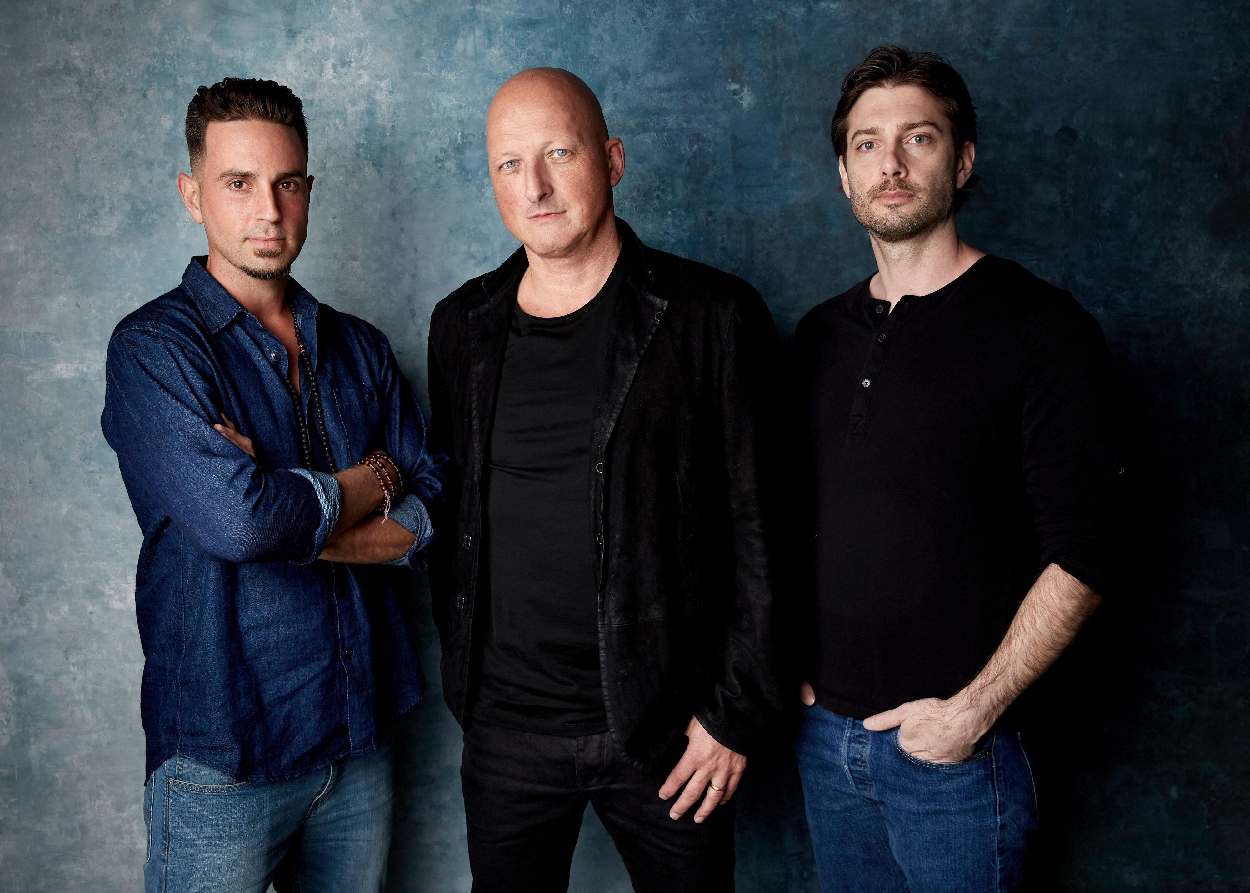 """Wade Robson, Dan Reed, James Safechuck. Wade Robson, from left, director Dan Reed and James Safechuck pose for a portrait to promote the film """"Leaving Neverland"""" at the Salesforce Music Lodge during the Sundance Film Festival, in Park City, Utah2019 Sundance Film Festival - """"Leaving Neverland"""" Portrait Session, Park City, USA - 24 Jan 2019"""