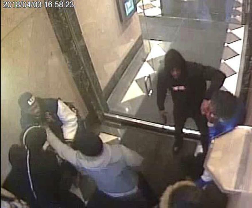This image provided by the U.S. Attorney's Office is said by authorities to show a violent robbery that the rapper 6ix9ine-- whose real name is Daniel Hernandez-- participated in, near Port Authority Bus Terminal in Manhattan.