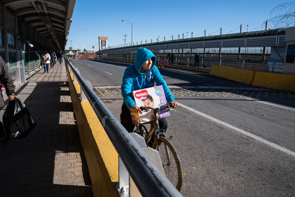 Jaime Caballero, from Reynosa, Tamaulipas, rides back home after buying diapers for his daughter in Hidalgo, Tex. on Dec. 9, 2018.Verónica G. Cárdenas for Rolling Stone