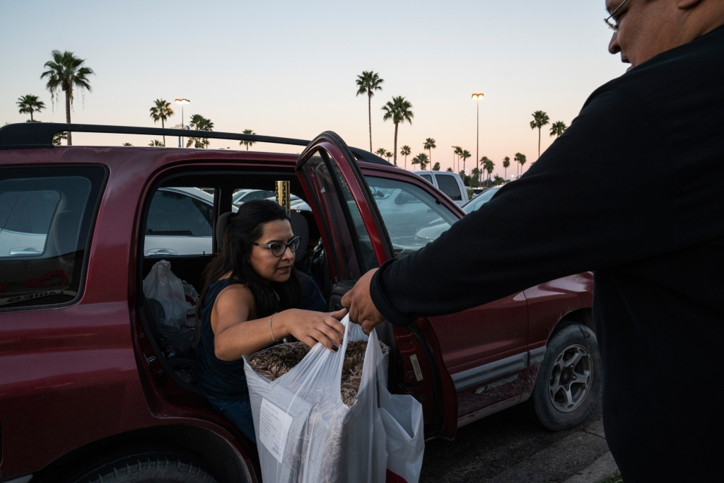 Shoppers from Reynosa, Tamaulipas get in their vehicles after shopping at Burlington in McAllen, Tex. on Dec. 9, 2018. Verónica G. Cárdenas for Rolling Stone