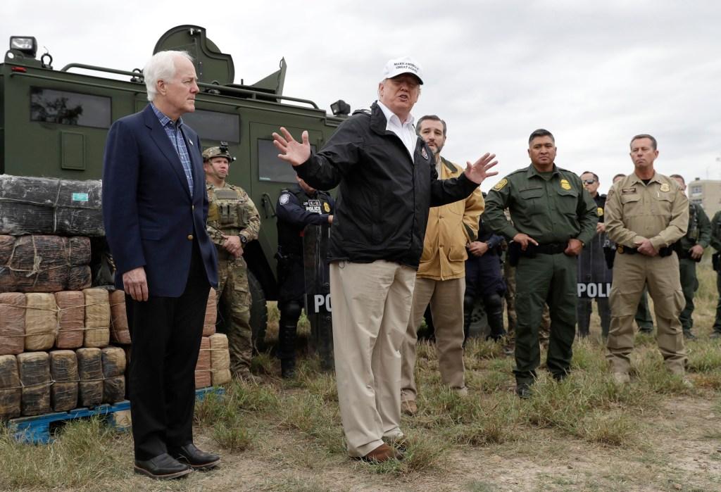 President Donald Trump speaks as tours the U.S. border with Mexico at the Rio Grande on the southern border, in McAllen, Texas, as Sen. John Cornyn, R-Texas, left, and Sen. Ted Cruz, R-Texas, listenTrump, McAllen, USA - 10 Jan 2019