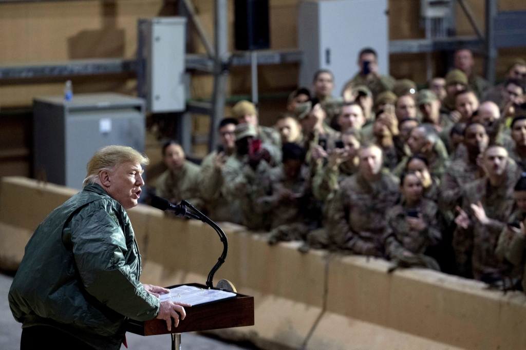 President Donald Trump speaks at a hanger rally at Al Asad Air Base, Iraq, . In a surprise trip to Iraq, President Donald Trump on Wednesday defended his decision to withdraw U.S. forces from Syria where they have been helping battle Islamic State militantsTrump Iraq - 26 Dec 2018