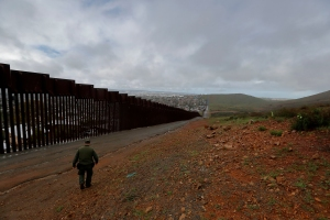 Border Patrol agent Vincent Pirro looks on near a border wall that separates the cities of Tijuana, Mexico, and San Diego, in San Diego. President Donald Trump is expected to speak about funding for a wall along the U.S.-Mexico border during his State of the Union address TuesdayBorder Wall, San Diego, USA - 05 Feb 2019