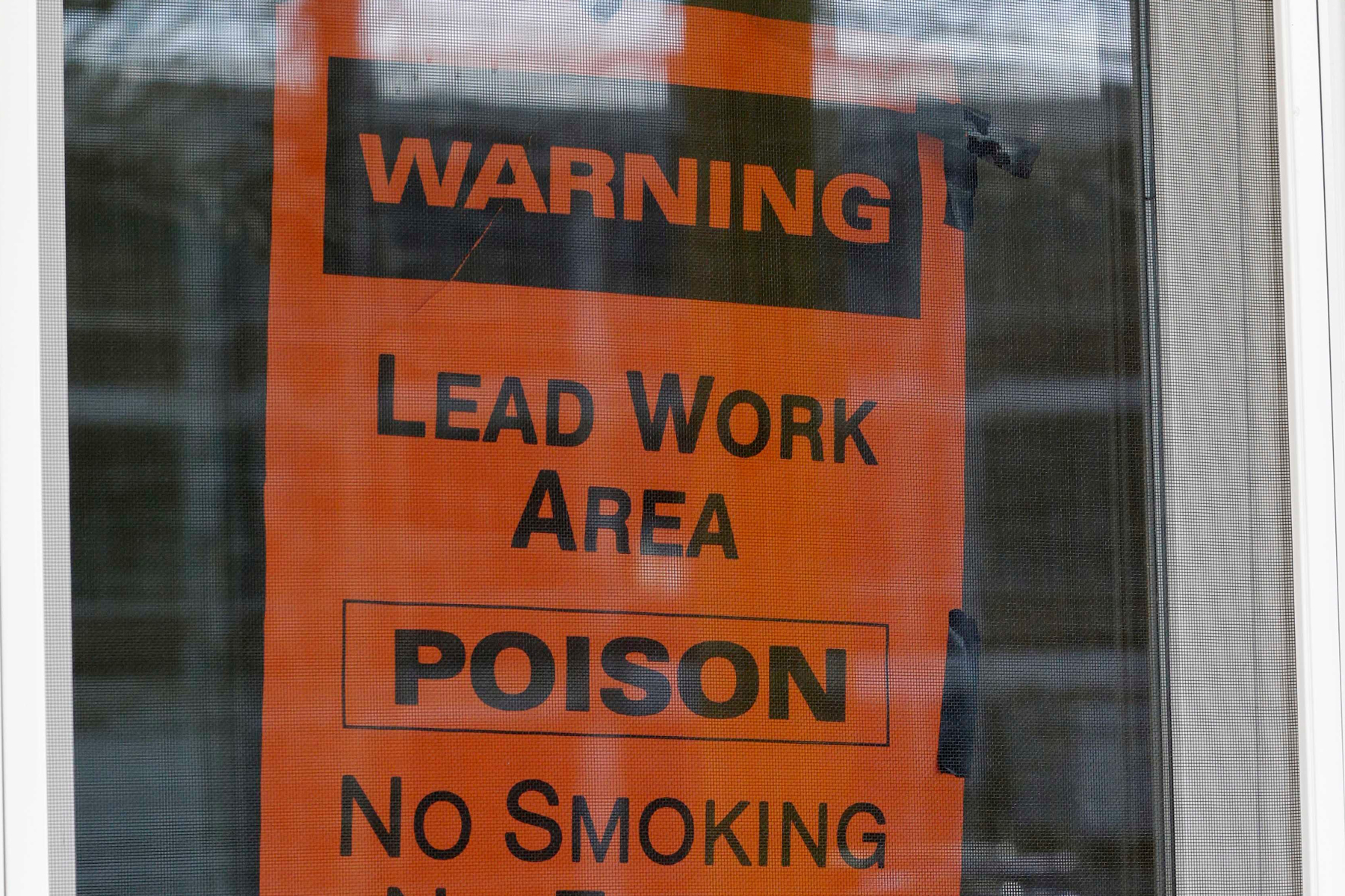 A sign hangs in a window, in Lakewood, Ohio. More than half a million U.S. children are now believed to have lead poisoning, roughly twice the previous high estimate, health officials reported Thursday. The increase is the result of the government last year lowering the threshold for lead poisoning, so now more children are considered at riskLead Poisoning, Lakewood, USA