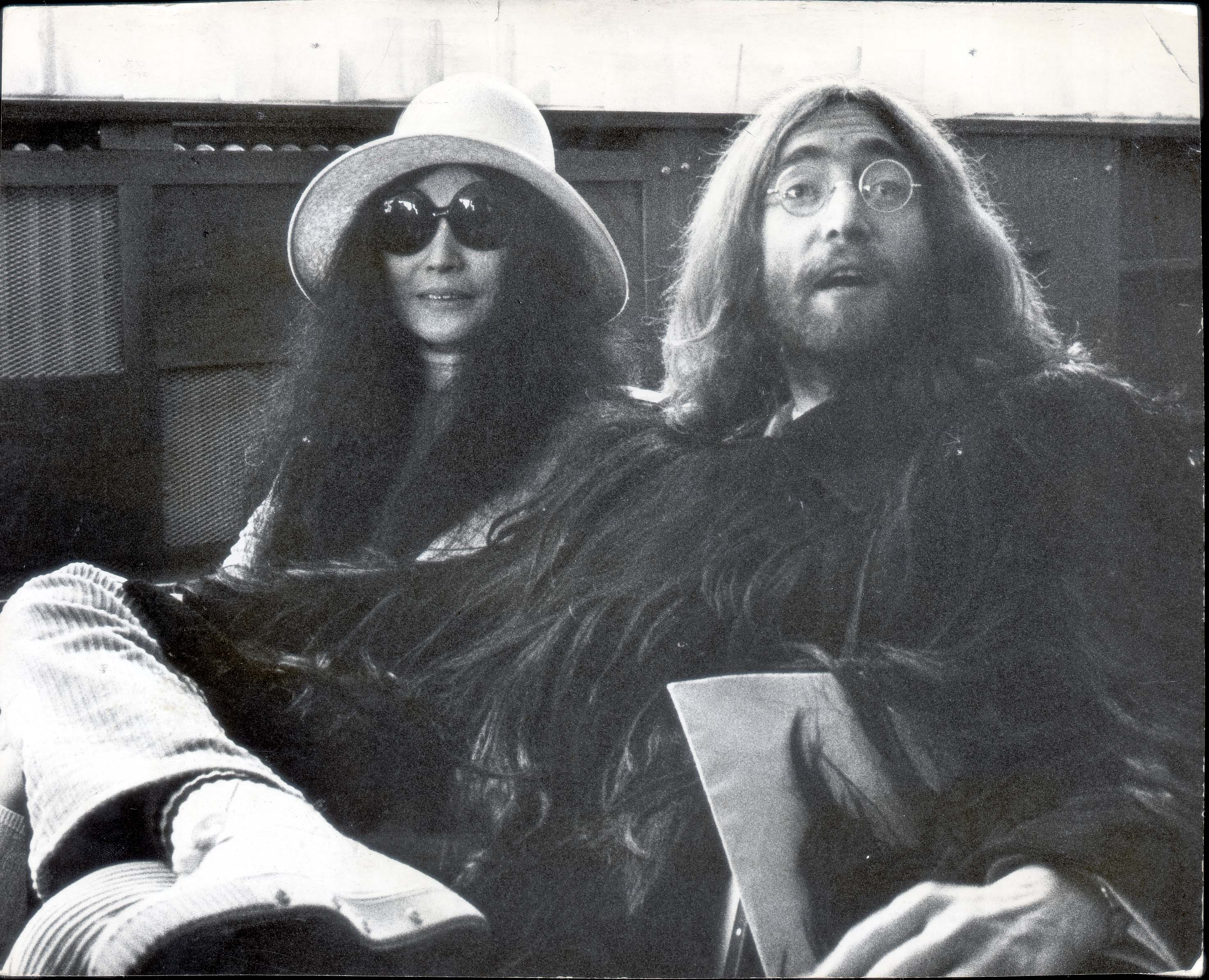 John Lennon And His Wife Yoko Ono Pictured Arriving In Paris Following Their Wedding In Gibraltar In 1969. John Lennon And His Wife Yoko Ono Pictured Arriving In Paris Following Their Wedding In Gibraltar In 1969.