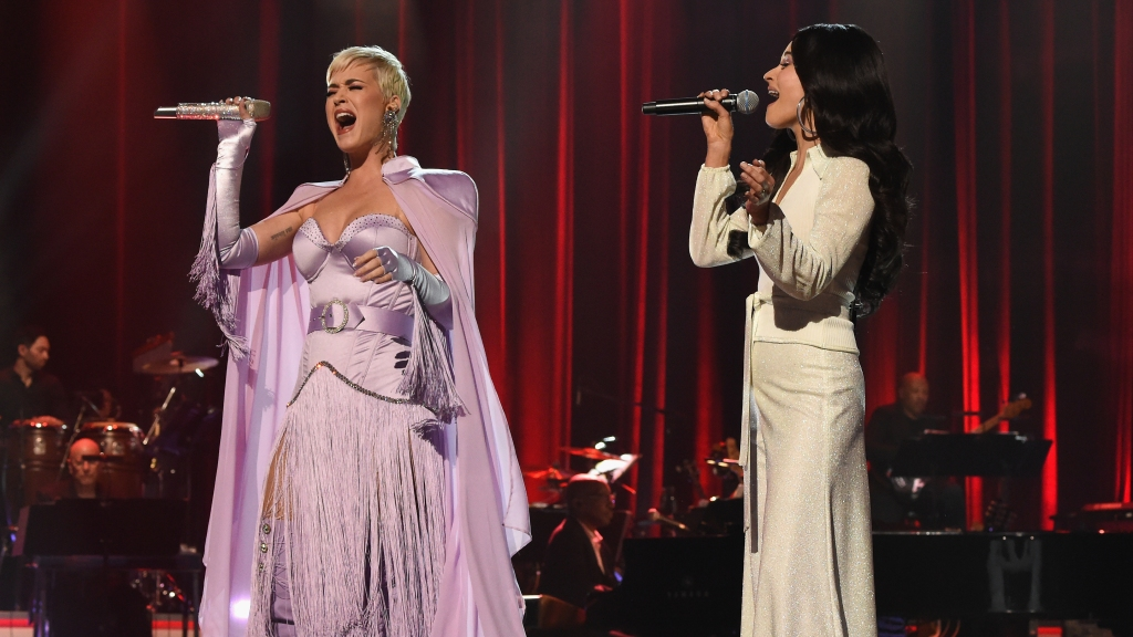 LOS ANGELES, CA - FEBRUARY 08: Katy Perry (L) and Kacey Musgraves perform onstage during MusiCares Person of the Year honoring Dolly Parton at Los Angeles Convention Center on February 8, 2019 in Los Angeles, California. (Photo by Kevin Mazur/Getty Images for NARAS)
