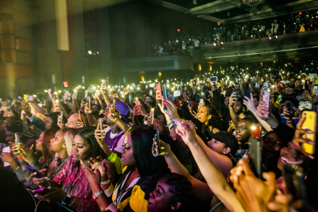 Fans raise their phones up to photograph Meek Mill as he performs at the Fillmore Miami on February 19th, 2019.