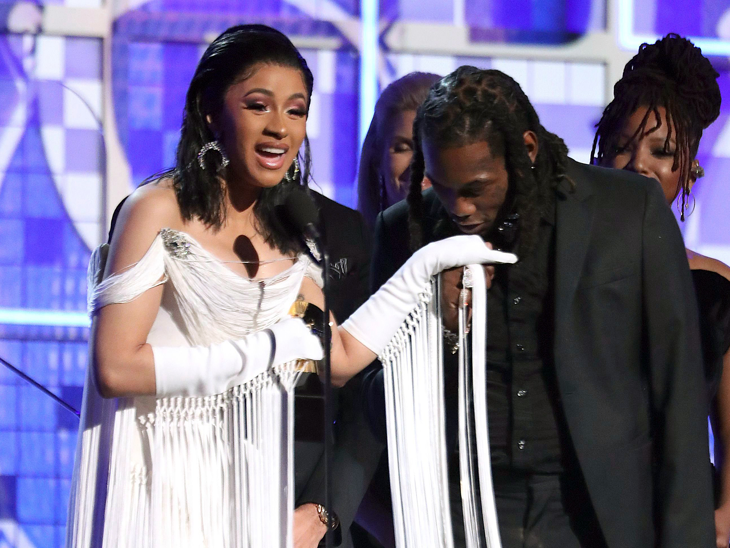 "Cardi B, Offset. Cardi B, left, accepts the award for best rap album for ""Invasion of Privacy"" as Offset kisses her hand at the 61st annual Grammy Awards, in Los Angeles61st Annual Grammy Awards - Show, Los Angeles, USA - 10 Feb 2019"