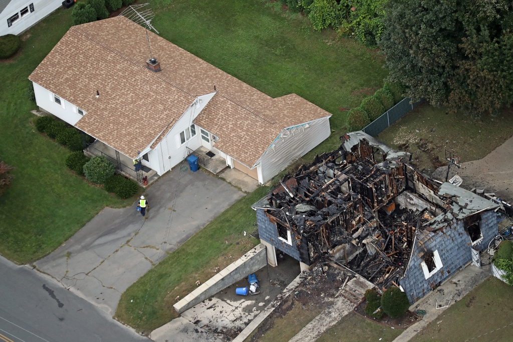 LAWRENCE, MA - SEPTEMBER 14: An aerial view shows a destroyed home in the aftermath of a series of fires and gas explosions in Lawrence, MA on Sep. 14, 2018. More than 60 fires and at least three gas explosions rocked Lawrence, North Andover, and Andover in a staccato burst of flame and fear late Thursday afternoon, damaging scores of buildings and prompting mass evacuations from homes served by Columbia Gas. State and local emergency workers descended quickly on the three Merrimack Valley communities, knocking down the fires, tending to the injured, and working through the night to inspect and shut off 8,000 gas meters. A Lawrence man died, and at least 25 others were injured in the fires, officials said. Leonel Rondon, 18, had been sitting inside a car when an explosion in Lawrence caused a chimney to fall on the vehicle, according to the Essex district attorneys office. (Photo by David L. Ryan/The Boston Globe via Getty Images)
