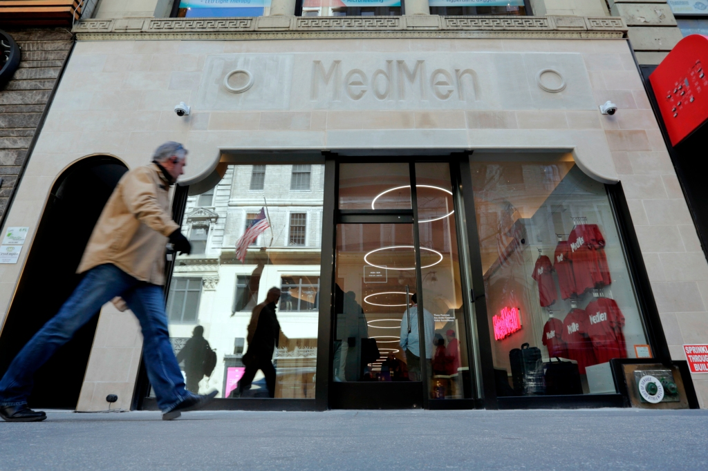 A pedestrian passes the MedMen store on New York's Fifth Avenue, . MedMen owns and operates licensed cannabis facilities in cultivation, manufacturing and retailMedical Marijuana , New York, USA - 20 Apr 2018