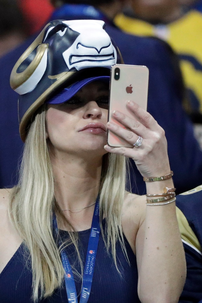 A Los Angeles Rams fans take a photo before the NFL Super Bowl 53 football game between the Los Angeles Rams and the New England Patriots, in AtlantaPatriots Rams Super Bowl Football, Atlanta, USA - 03 Feb 2019
