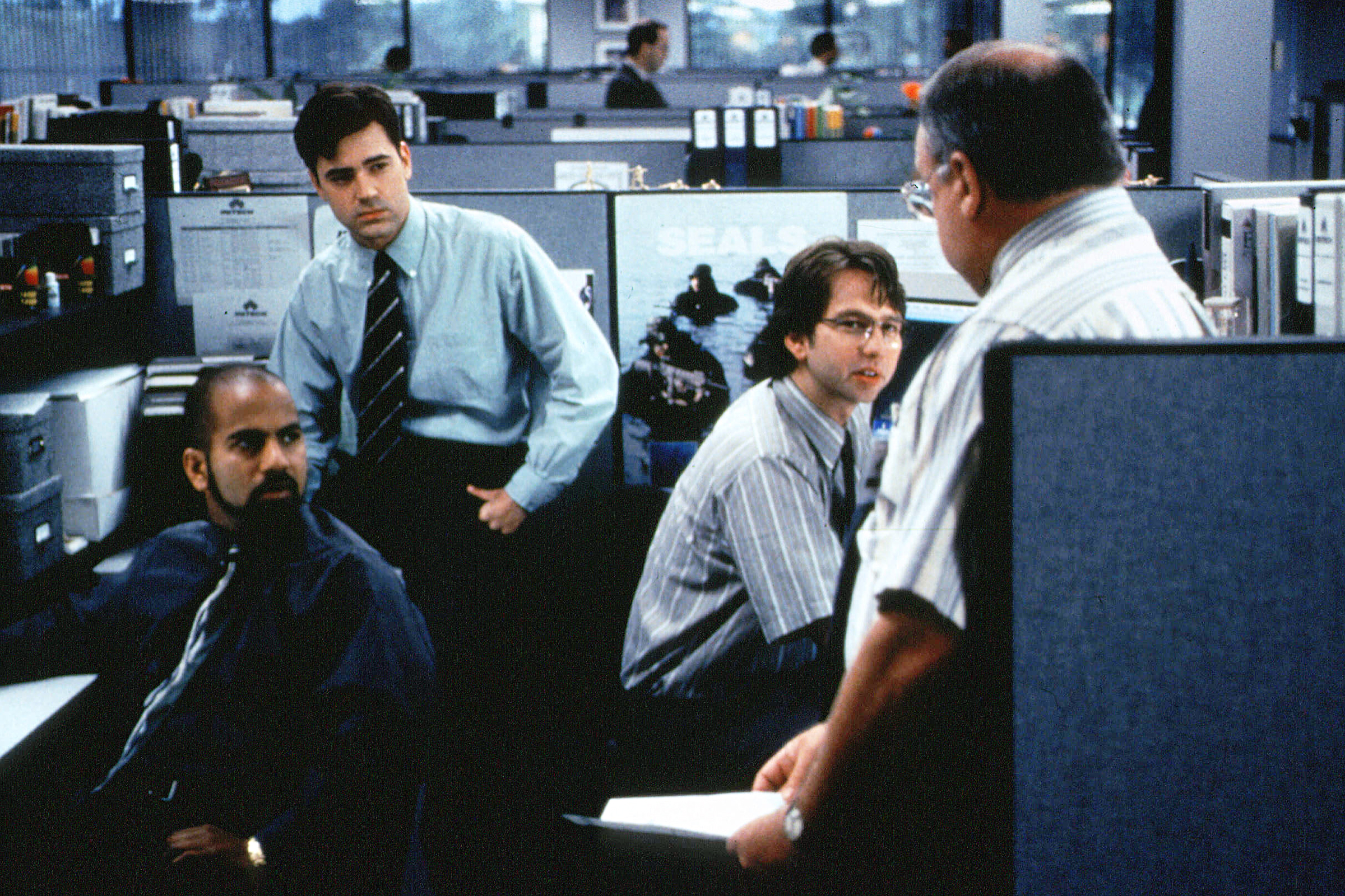 Ajay Naidu, Ron Livingston, David Herman and Richard Riehle in 'Office Space.'