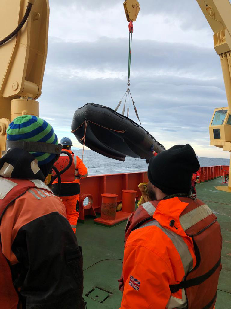 A zodiac being lifted onto the ship. Photo by Jeff Goodell
