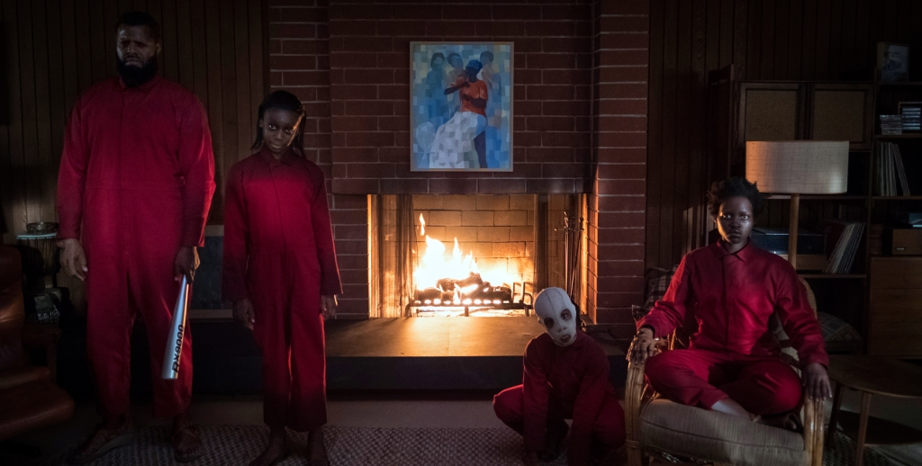 "The Wilson family doppelgängers (from left) Abraham (Winston Duke), Umbrae (Shahadi Wright Joseph), Pluto (Evan Alex) and Red (Lupita Nyong'o) in ""Us,"" written, produced and directed by Jordan Peele."